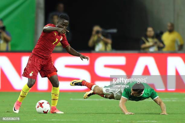 David Accam of Ghana fights for the ball with Jesus Dueñas of Mexico during the friendly match between Mexico and Ghana at NRG Stadium on June 28...