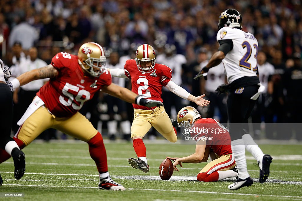 David Akers #2 of the San Francisco 49ers attempts a field goal in the second half against Chykie Brown #23 of the Baltimore Ravens during Super Bowl XLVII at the Mercedes-Benz Superdome on February 3, 2013 in New Orleans, Louisiana.
