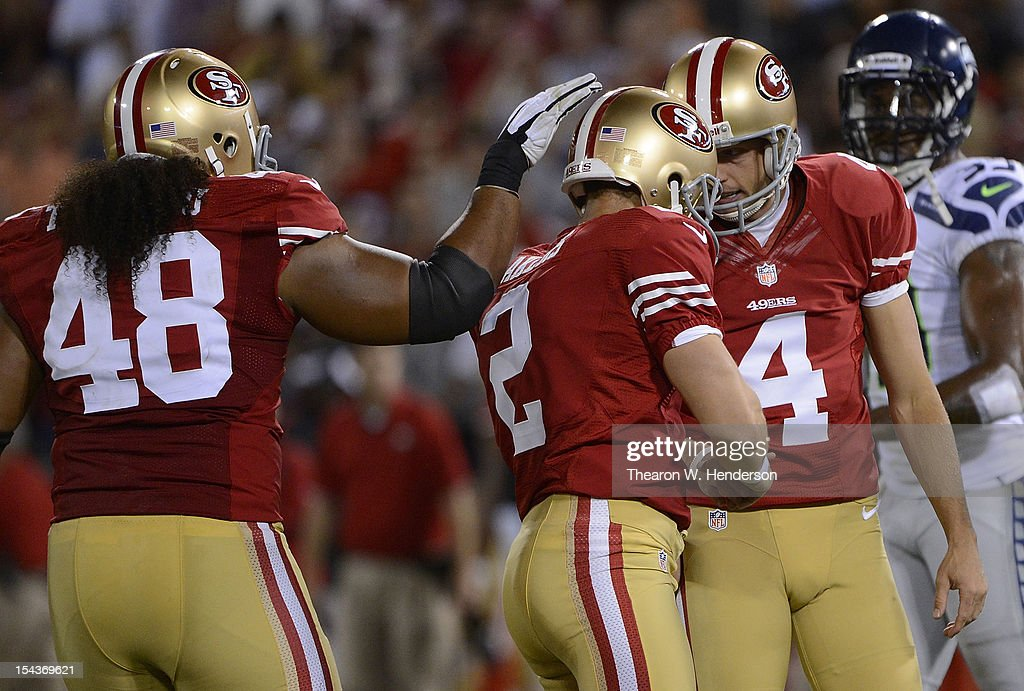 <a gi-track='captionPersonalityLinkClicked' href=/galleries/search?phrase=David+Akers&family=editorial&specificpeople=208094 ng-click='$event.stopPropagation()'>David Akers</a> #2 of the San Francisco 49ers is congratulated by Andy Lee #4 and Will Tukuafu #48 after Akers kicked a twenty eight yard field goal against the Seattle Seahawks during the fourth quarter of an NFL football game at Candlestick Park on October 18, 2012 in San Francisco, California. The 49ers won the game 13-6.