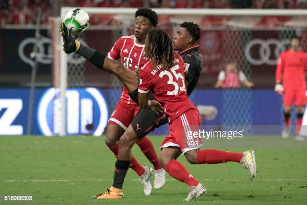 David Alaba and Renato Sanches of Bayern Muenchen and Alex Iwobi of Arsenal compete for the ball during 2017 International Champions Cup China...