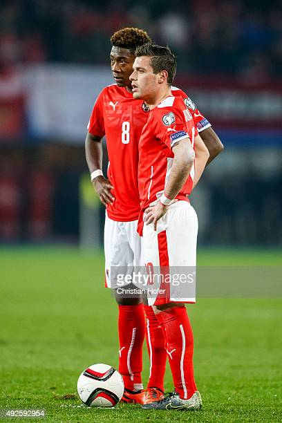 David Alaba and Zlatko Junuzovic of Austria look on during the national anthem prior to during the UEFA EURO 2016 Qualifier between Austria and...