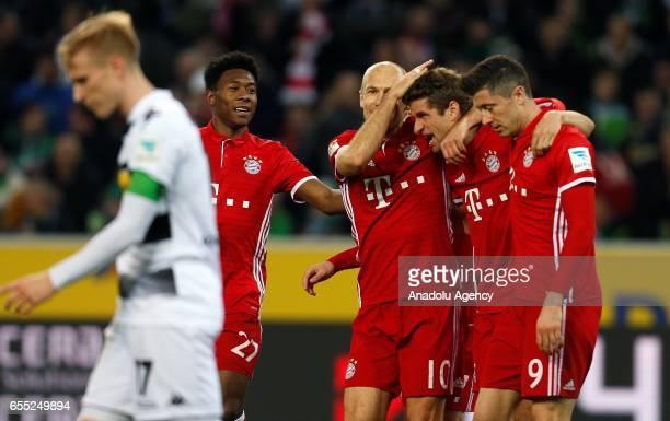 David Alaba Arjen Robben Thomas Mueller and Robert Lewandowski of Bayern Munich celebrate scoring a goal during the Bundesliga Match between Borussia...