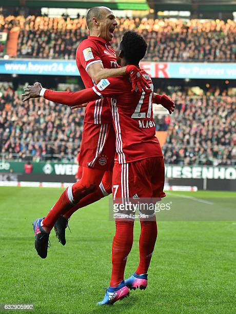 David Alaba celebrates scoring the second goal with Arjen Robben of Muenchen during the Bundesliga match between Werder Bremen and Bayern Muenchen at...