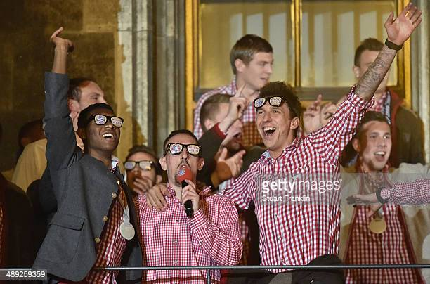 David Alaba Franck Ribery and Mario Mandzukic of FC Bayern Muenchen celebrate at the Rathaus on May 10 2014 in Munich Germany