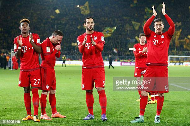 David Alaba Franck Ribery Mehdi Benatia and Robert Lewandowski of Bayern Munich applaud away supporters after their team's scoreless draw in the...