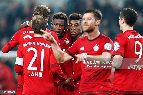 David Alaba Kingsley Coman Philipp Lahm and Xabi Alonso celebrate after teammate Thomas Muller of Bayern Muenchen scores his teams third goal of the...