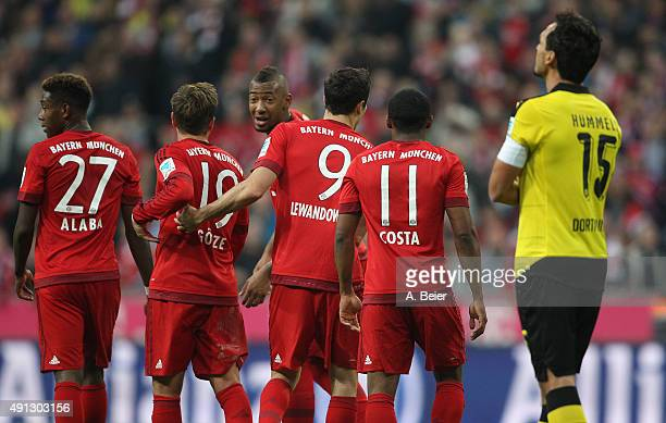 David Alaba Mario Goetze Jerome Boateng Robert Lewandowski and Douglas Costa of Bayern Muenchen celebrate their goal as Mats Hummel of Borussia...