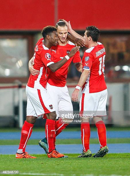 David Alaba Marko Arnautovic and Zlatko Junuzovic of Austria celebrate after scoring the first goal during the UEFA EURO 2016 Qualifier between...