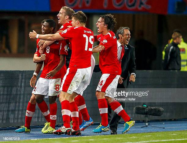 David Alaba of Austria celebrates with his team mates and Coach Marcel Koller after scoring during the FIFA World Cup 2014 Group C qualification...