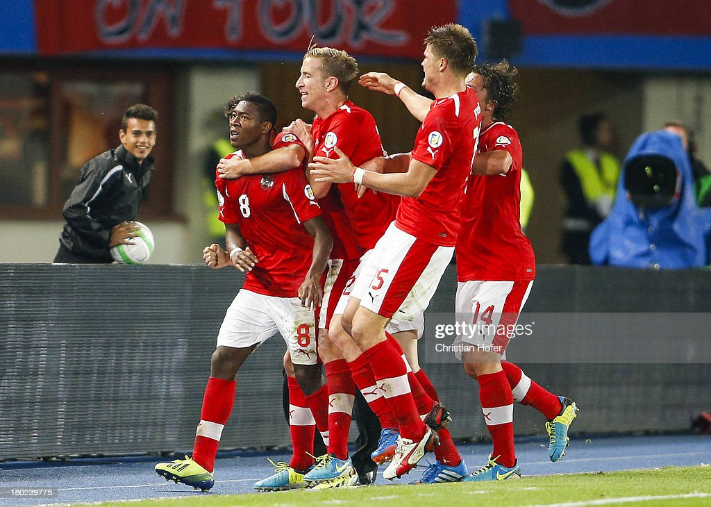 <a gi-track='captionPersonalityLinkClicked' href=/galleries/search?phrase=David+Alaba&family=editorial&specificpeople=5494608 ng-click='$event.stopPropagation()'>David Alaba</a> of Austria celebrates with team mates after scoring during the FIFA World Cup 2014 Group C qualification match between Austria and the Republic of Ireland at the Ernst Happel Stadium on September 10, 2013 in Vienna, Austria.