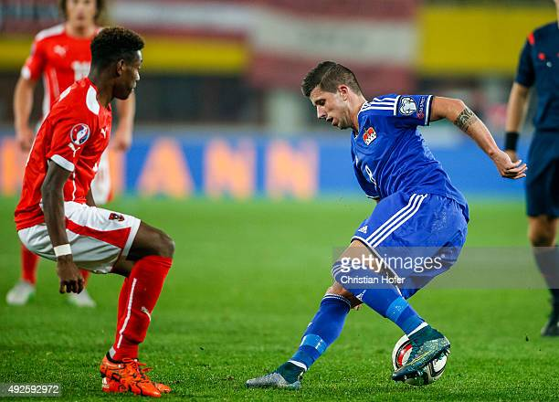 David Alaba of Austria competes for the ball with Sandro Wieser of Liechtenstein during the UEFA EURO 2016 Qualifier between Austria and...