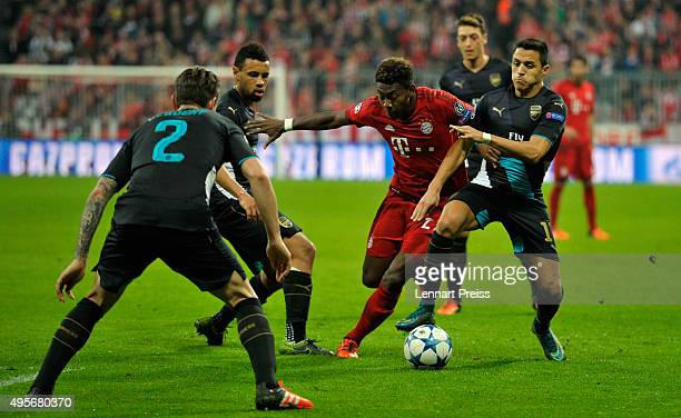 David Alaba of Bayern Muenchen and Alexis Sanchez of Arsenal compete for the ball during the UEFA Champions League Group F match between FC Bayern...