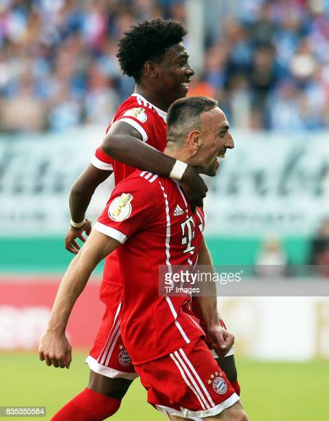 David Alaba of Bayern Muenchen and Franck Ribery of Bayern Muenchen celebrate their win during the DFB Cup first round match between Chemnitzer FC...