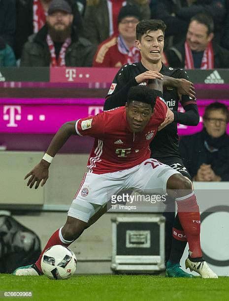 David Alaba of Bayern Muenchen and Kai Havertz of Bayer 04 Leverkusen battle for the ball during the Bundesliga match between FC Bayern Muenchen and...
