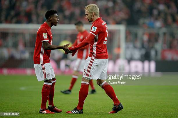 David Alaba of Bayern Muenchen and Mats Hummels of Bayern Muenchen embrace during the Bundesliga match between Bayern Muenchen and RB Leipzig at...