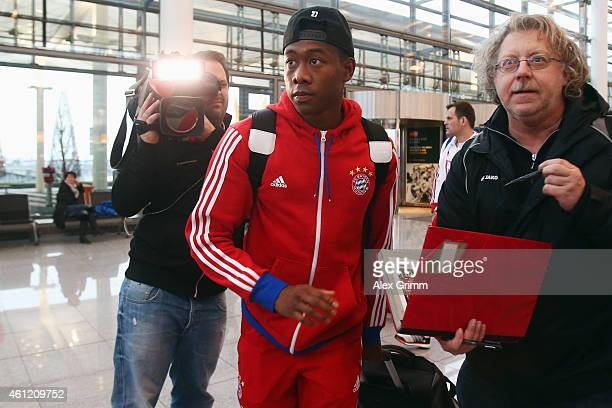 David Alaba of Bayern Muenchen arrives at the airport for the departure to the team's training camp in Doha Qatar on January 9 2015 in Munich Germany
