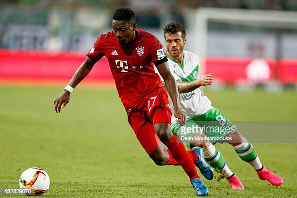 David Alaba of Bayern Muenchen battles for the ball with Vieirinha of VfL Wolfsburg during the DFL Supercup match between VfL Wolfsburg and FC Bayern...