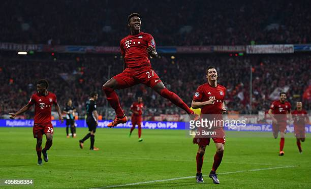 David Alaba of Bayern Muenchen celebrates scoring his side's third goal during the UEFA Champions League Group F match between FC Bayern Muenchen and...