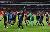 David Alaba of Bayern Muenchen celebrates victory with team mates after the UEFA Champions League quarter final second leg match between SL Benfica...
