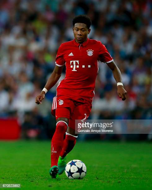 David Alaba of Bayern Muenchen controls the ball during the UEFA Champions League Quarter Final second leg match between Real Madrid CF and FC Bayern...