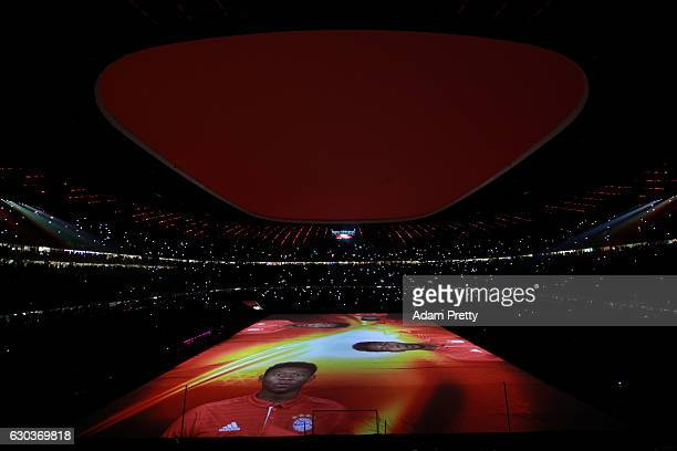 David Alaba of Bayern Muenchen display is seen during the light show after the final whistle during the Bundesliga match between Bayern Muenchen and...