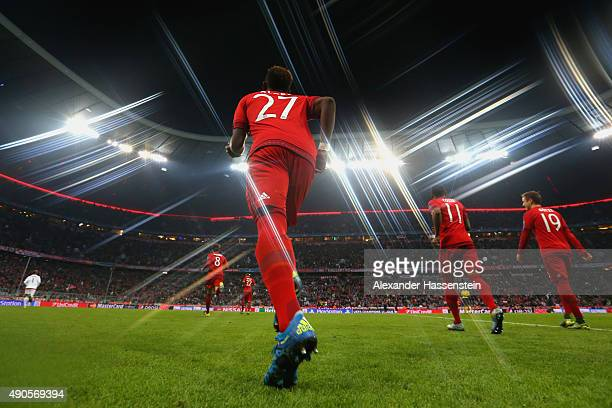 David Alaba of Bayern Muenchen enters the field with his team mates for the UEFA Champions League Group F match between FC Bayern Munchen and GNK...