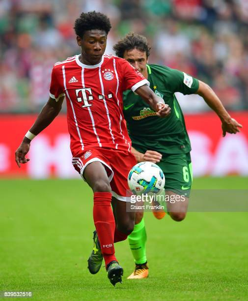 David Alaba of Bayern Muenchen is chased by Thomas Delaney of Bremen during the Bundesliga match between SV Werder Bremen and FC Bayern Muenchen at...