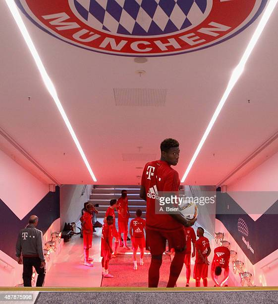 David Alaba of Bayern Muenchen looks back as he arrives at the players' tunnel before the Bundesliga match between FC Bayern Muenchen and FC Augsburg...