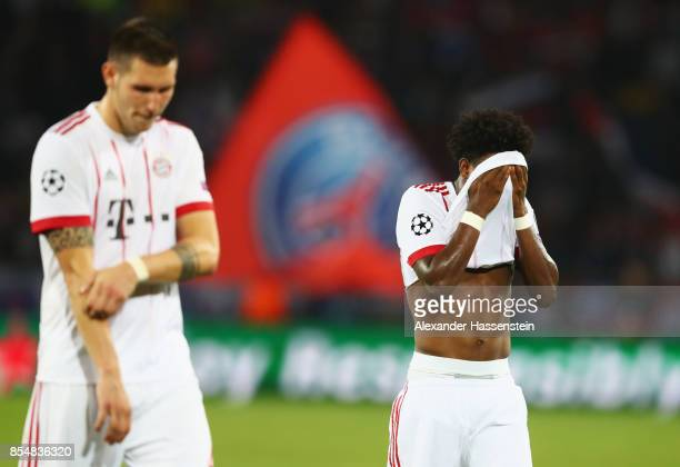 David Alaba of Bayern Muenchen looks dejected following defeat during the UEFA Champions League group B match between Paris SaintGermain and Bayern...