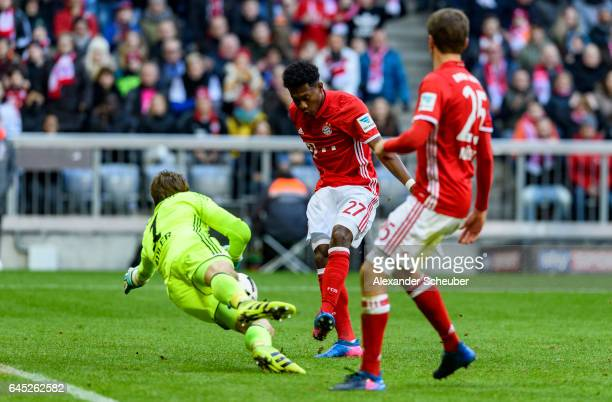 David Alaba of Bayern Muenchen scores the fifth goal for his team against Rene Adler of Hamburg during the Bundesliga match between Bayern Muenchen...