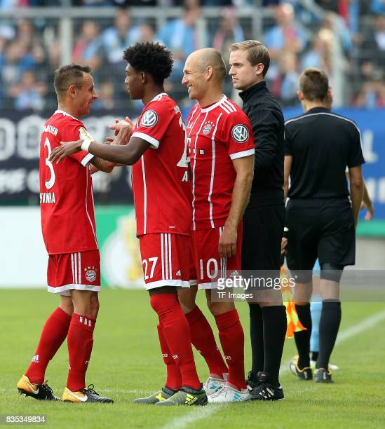 David Alaba of Bayern Muenchen shakes hands with Rafinha of Bayern Muenchen and Arjen Robben of Bayern Muenchen during the DFB Cup first round match...