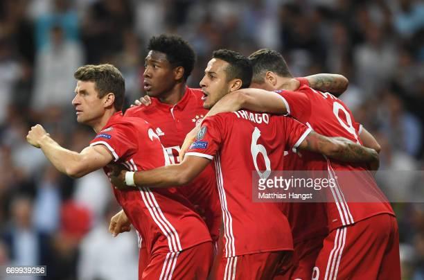 David Alaba of Bayern Muenchen Thiago Alcantara of Bayern Muenchen Thomas Mueller of Bayern Muenchen and Robert Lewandowski of Bayern Muenchen...