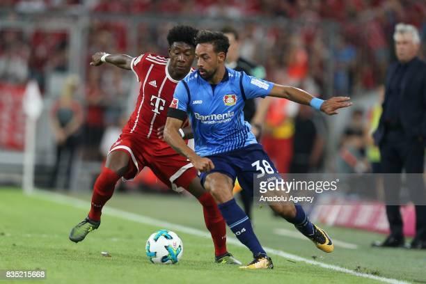 David Alaba of Bayern Munich and Karim Bellarabi of Bayer 04 Leverkusen vie for the ball during the German First division Bundesliga soccer match...