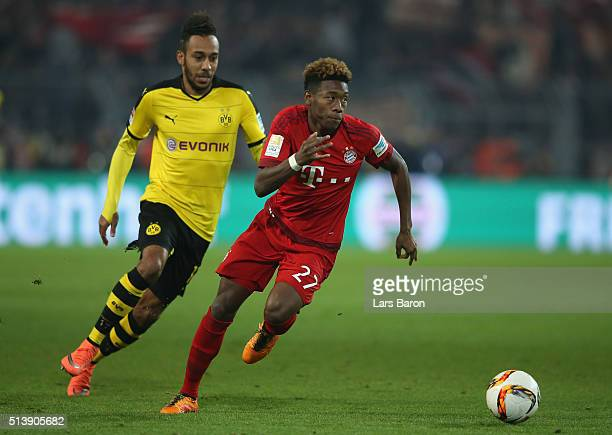 David Alaba of Bayern Munich and PierreEmerick Aubameyang of Borussia Dortmund compete for the ball during the Bundesliga match between Borussia...