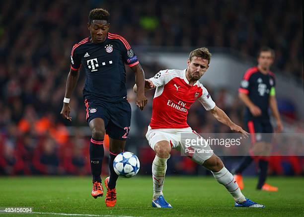 David Alaba of Bayern Munich evades Nacho Monreal of Arsenal during the UEFA Champions League Group F match between Arsenal FC and FC Bayern Munchen...