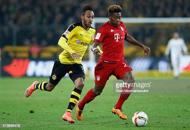 David Alaba of Bayern Munich is chased by PierreEmerick Aubameyang of Borussia Dortmund during the Bundesliga match between Borussia Dortmund and FC...