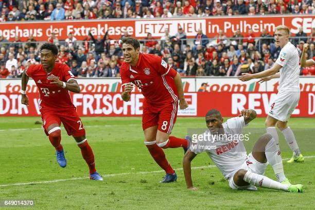 David Alaba of Bayern Munich Javi Martinez of Bayern Munich Anthony Modeste of 1FC Koln Frederik Sorensen of 1FC Kolnduring the Bundesliga match...