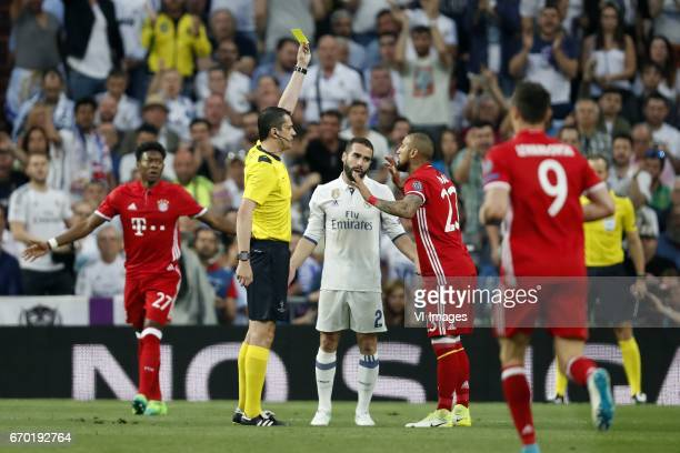 David Alaba of Bayern Munich referee Viktor Kassai Daniel Carvajal of Real Madrid Arturo Vidal of Bayern Munich Robert Lewandowski of Bayern...