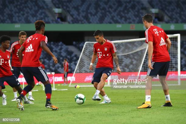 David Alaba of FC Bayern Muenchen battle for the ball with his team mates Thomas Mueller Kinglsey Coman James Rodriquez and Robert Lewandowski during...