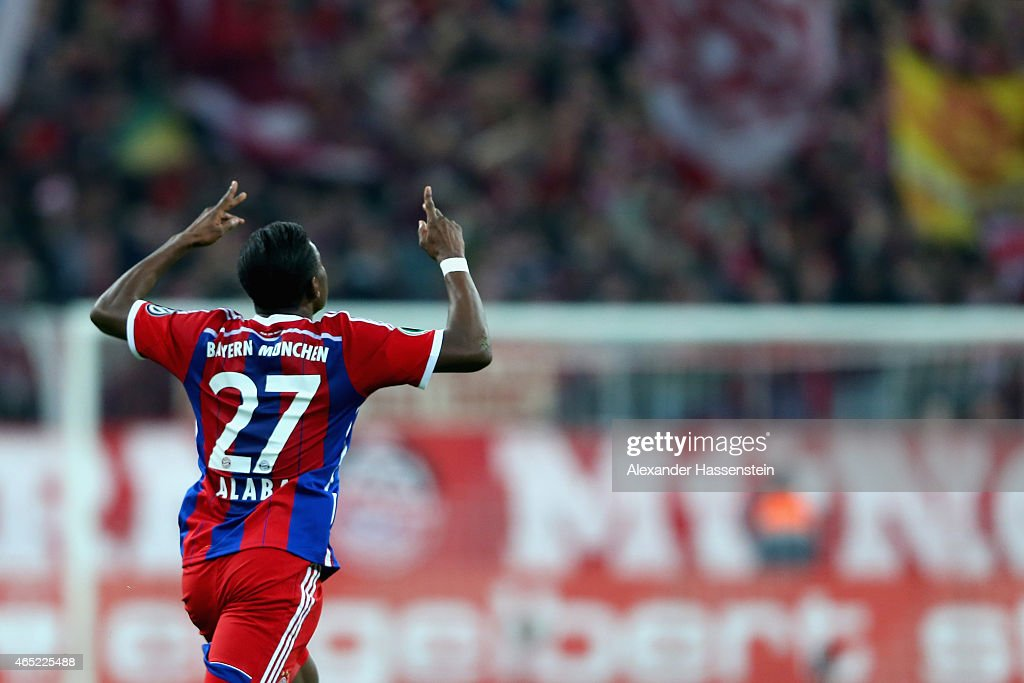 David Alaba of FC Bayern Muenchen celebrates as he scores the opening goal from a free kick during the round of 16 DFB Cup match between FC Bayern Muenchen and Eintracht Braunschweig at Allianz Arena on March 4, 2015 in Munich, Germany.