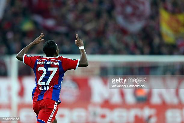 David Alaba of FC Bayern Muenchen celebrates as he scores the opening goal from a free kick during the round of 16 DFB Cup match between FC Bayern...