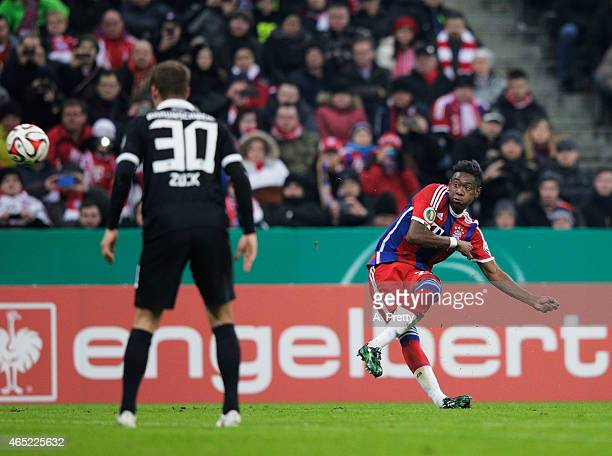David Alaba of FC Bayern Muenchen celebrates scores the first goal during the DFB Cup match between FC Bayern Muenchen and Eintracht Braunschweig at...