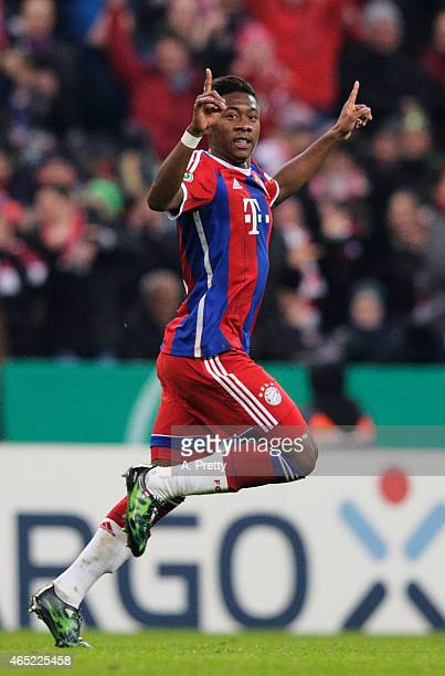 David Alaba of FC Bayern Muenchen celebrates scoring the first goal during the DFB Cup match between FC Bayern Muenchen and Eintracht Braunschweig at...
