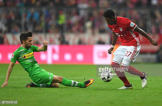David Alaba of FC Bayern Muenchen challenges Julian Korb of Borussia Moenchengladbach during the Bundesliga match between FC Bayern Muenchen and...