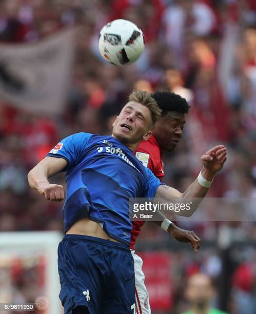 David Alaba of FC Bayern Muenchen heads for the ball with Felix Platte of SV Darmstadt during the Bundesliga match between Bayern Muenchen and SV...