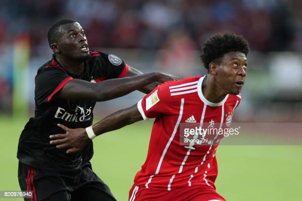 David Alaba of FC Bayern Muenchen in action against MBaye Niang of AC Milan during the 2017 International Champions Cup football match between AC...