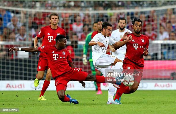 David Alaba of FC Bayern Muenchen is challenged by Lucas Vazquez of Real Madird during the Audi Cup 2015 final match between FC Bayern Muenchen and...