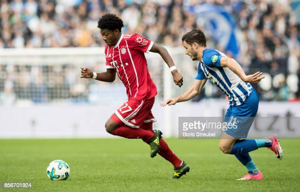 David Alaba of FC Bayern Muenchen is challenged by Mathew Leckie of Hertha BSC during the Bundesliga match between Hertha BSC and FC Bayern Muenchen...