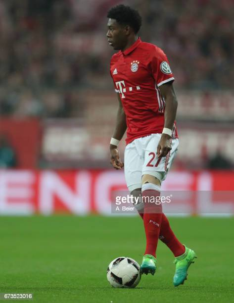David Alaba of FC Bayern Muenchen kicks the ball during the DFB Cup semi final match between FC Bayern Muenchen and Borussia Dortmund at Allianz...