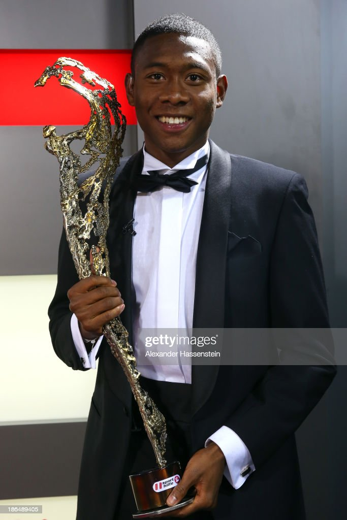David Alaba of FC Bayern Muenchen poses with his Austria's Sportsmen of the Year 2013 award at Bayern Muenchen's headquater Saebener Strasse on...